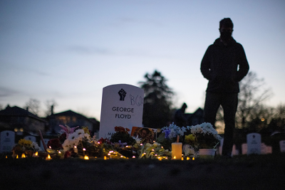 """A local resident stands at the """"Say Their Names"""" cemetery on the day of the guilty verdict in the trial of former Minneapolis police officer Derek Chauvin, at George Floyd Square in Minneapolis."""