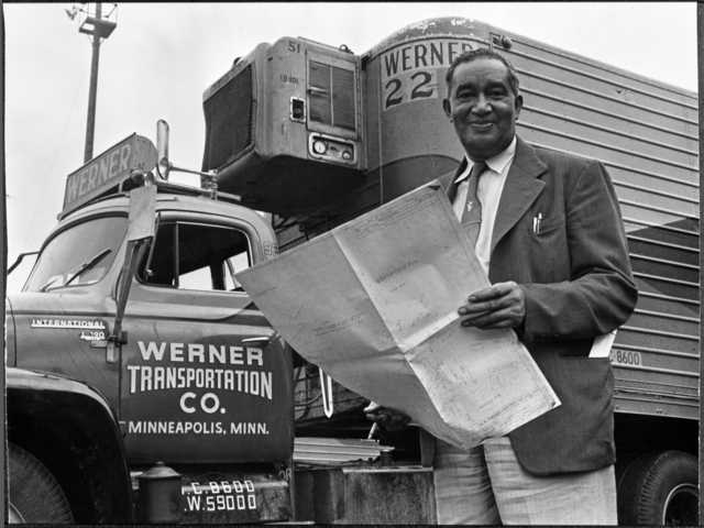 historic photo of frederick mckinley jones standing in front of a refrigerated truck