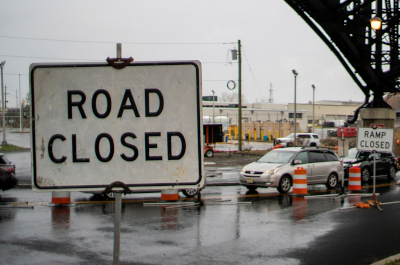 photo of road closed sign with road construction in background