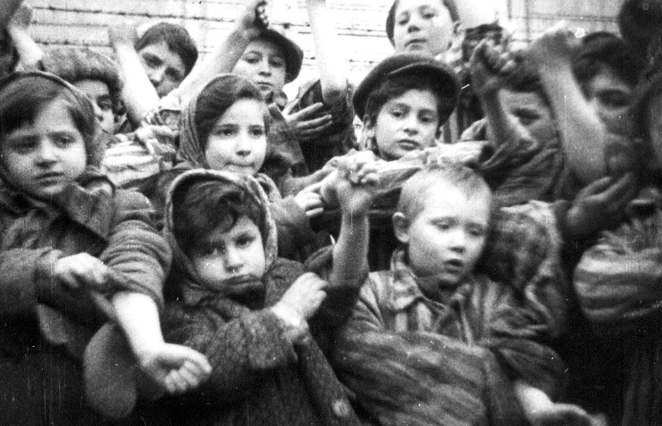 Some of the 600 children who had survived the Auschwitz II-Birkenau showing their tattooed identification numbers.