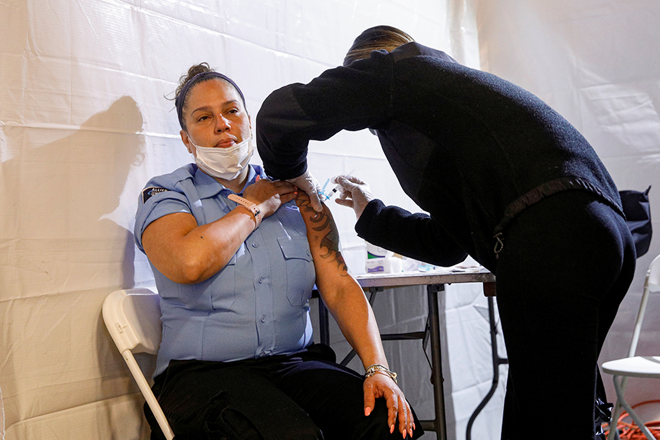 Metropolitan Transportation Authority security contractor Janet Santiago receiving a shot of the Johnson & Johnson vaccine during the opening of MTA's public vaccination program at the Coney Island subway station in Brooklyn.