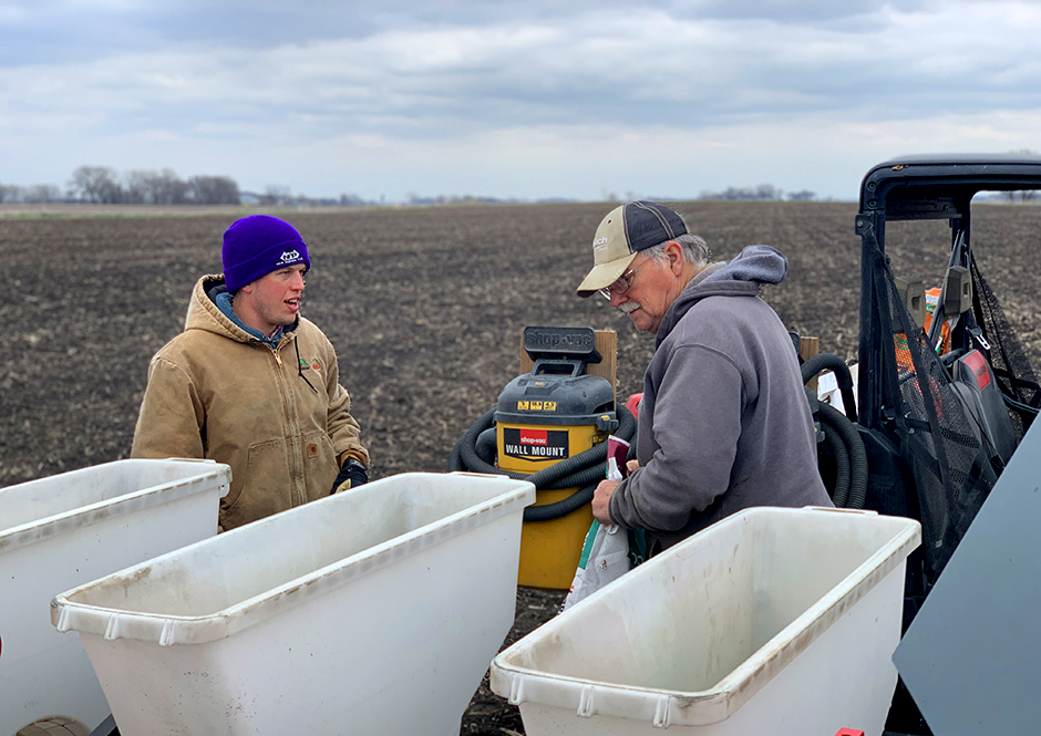 Trimont crop consultant Stephan Melson, left, and Odin farmer Tom Peterson load a planter with corn seed near Butterfield, in southwestern Minnesota, in late April.
