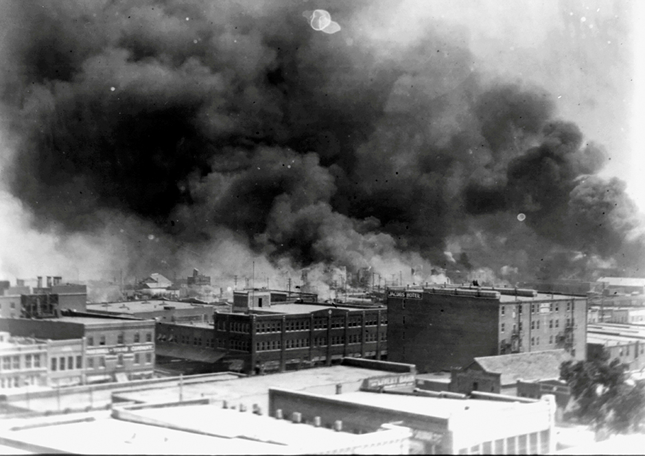 Smoke rises from buildings during the race massacre in Tulsa, Oklahoma, on May 31, 1921.