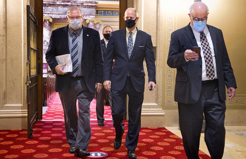 State Sen. Tom Bakk, Senate Majority Leader Paul Gazelka and state Sen. David Tomassoni shown leaving the floor of the Minnesota Senate.
