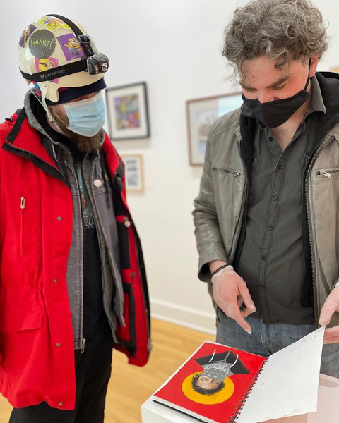 Blaine Garrett, right, on opening night of Gamut Gallery's MPLSART Sketchbook Project show in April.