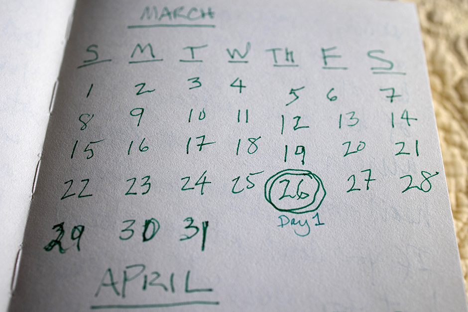A journal kept by long-hauler Penny Parkin, 69, to document her experiences, shows a calendar drawn with the date March 26, 2020 circled to highlight the day Parkin first began experiencing symptoms.
