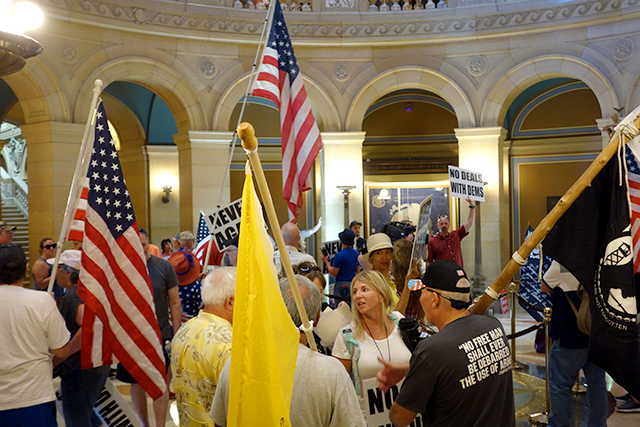 Protesters rallied in the Rotunda, attempting to discourage Senate Majority Leader Paul Gazelka from compromising with Democratic legislators.