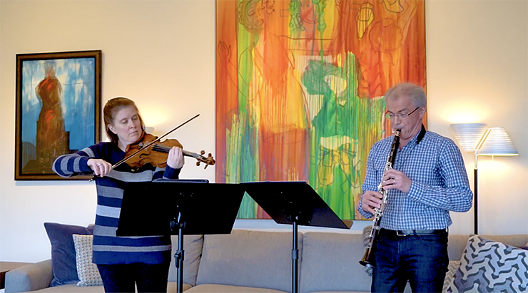 """Erin Keefe and Osmo Vänska at their home in Minneapolis, where they played and recorded a series of performances for the Orchestra's """"Minnesota Orchestra at Home"""" video series."""