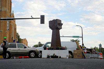 A new fist sculpture stands in George Floyd Square.
