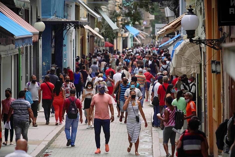 People walking in a commercial street in Havana, Cuba, June 15, 2021.