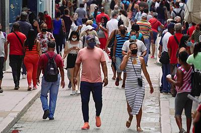 People walking in a commercial street in Havana