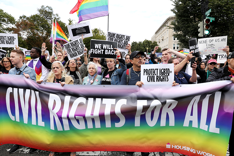LGBTQ activists and supporters shown at a 2019 rally outside the U.S. Supreme Court Building.