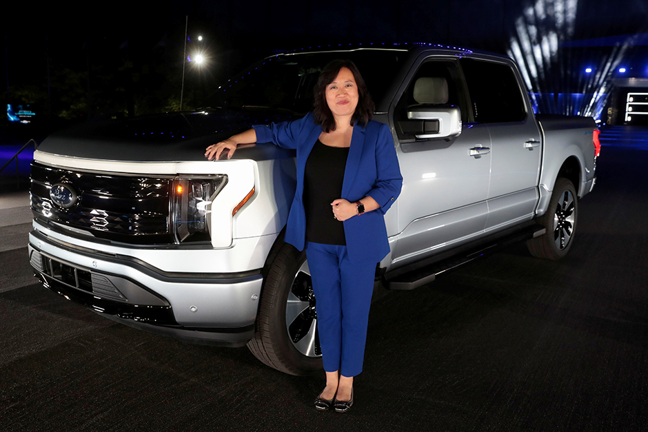 Chief engineer Linda Zhang posing next to the all-electric Ford F-150 Lightning pickup truck during the unveiling at the company's world headquarters in Dearborn, Michigan, on May 19.