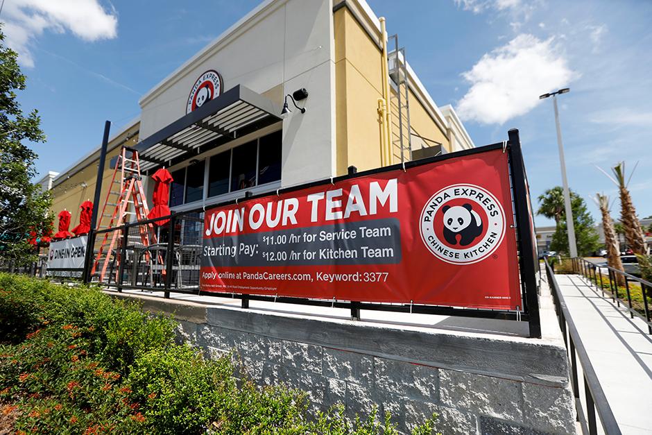"A Panda Express restaurant in Tampa, Florida, displaying a ""Now Hiring"" sign."