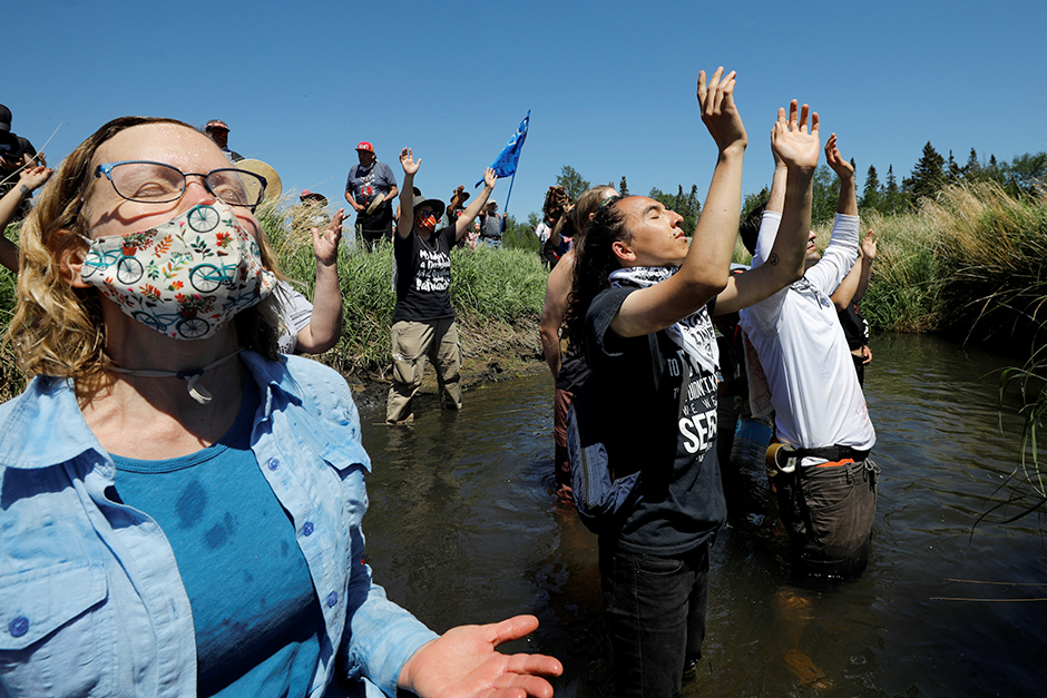 Indigenous leaders and activists participate in a prayer at the Mississippi headwaters on the third day of the Treaty People Gathering, an organized protest of the Line 3 pipeline, in Solway, on Monday.