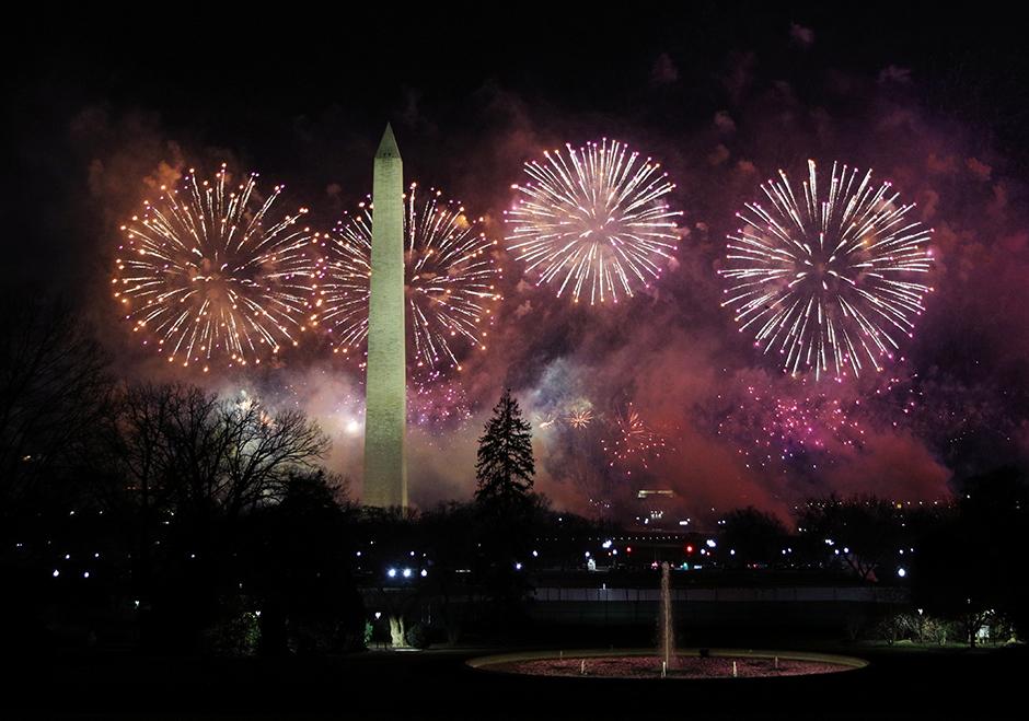 Fireworks bursting over the Washington Monument.