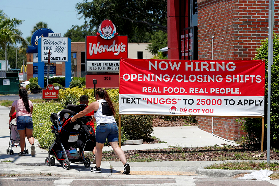 """A Wendy's restaurant displays a """"Now Hiring"""" sign in Tampa, Florida."""