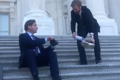 screenshot of video of dean phillips and peter meijer exchanging a shoe