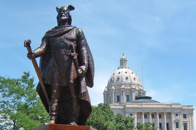 photo of statue of leif erikson with minnesota capitol in background