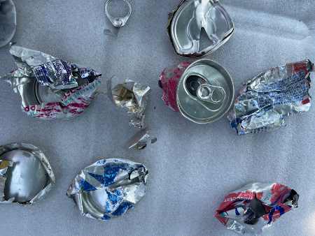 photo of ripped apart soda cans