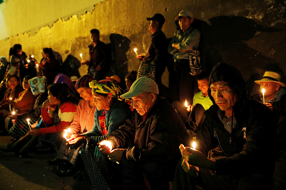 Indigenous people of the Ixil region holding a vigil on September 26, 2018, outside a courtroom during the trial of former military intelligence chief Jose Mauricio Rodriguez, accused of genocide and crimes against humanity, in Guatemala City, Guatemala.