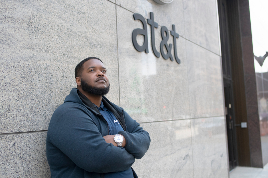 photo of james rudd leaning against at&t building