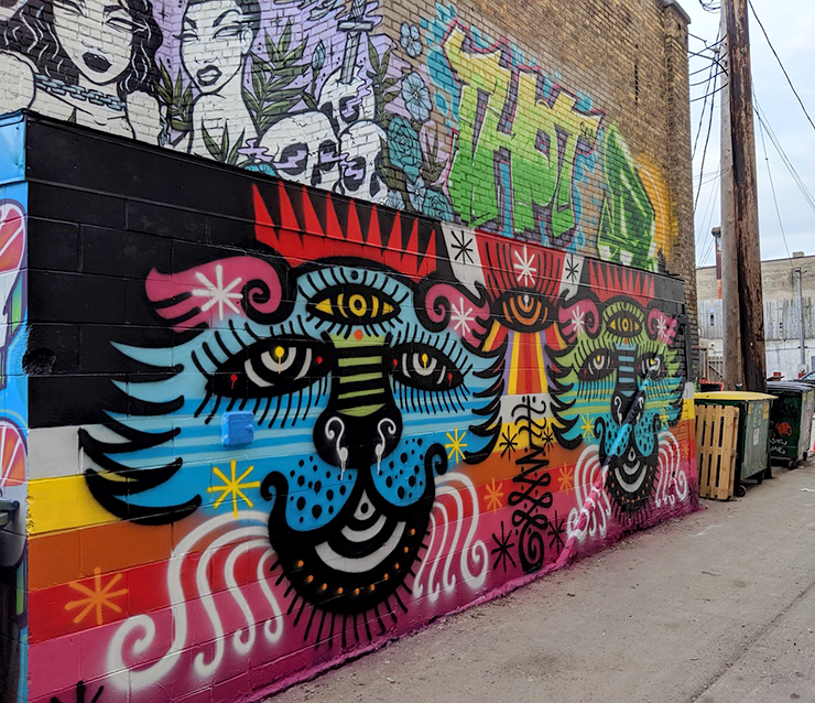 A mural from a past LynLake Street Art Festival.