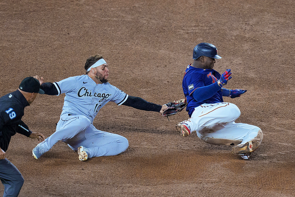 Chicago White Sox third baseman Yoan Moncada tagging out Minnesota Twins first baseman Miguel Sano in the seventh inning of Tuesday night's game at Target Field.