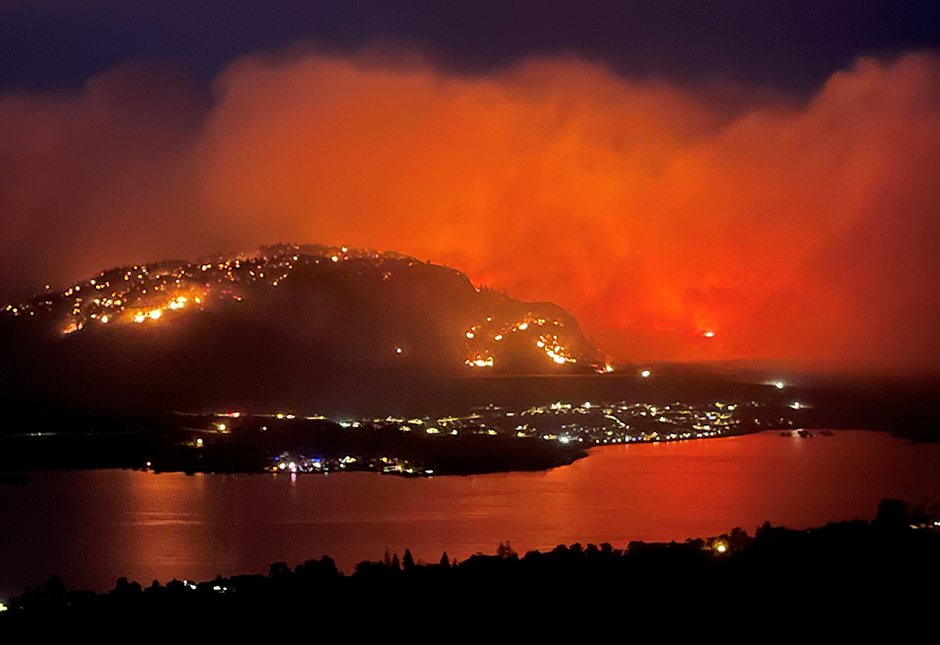 Smoke billows from a wildfire, seen from a Highway 3 lookout near Osoyoos city, British Columbia.