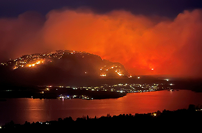 Smoke billows from a wildfire, seen from a Highway 3 lookout near Osoyoos city, British Columbia