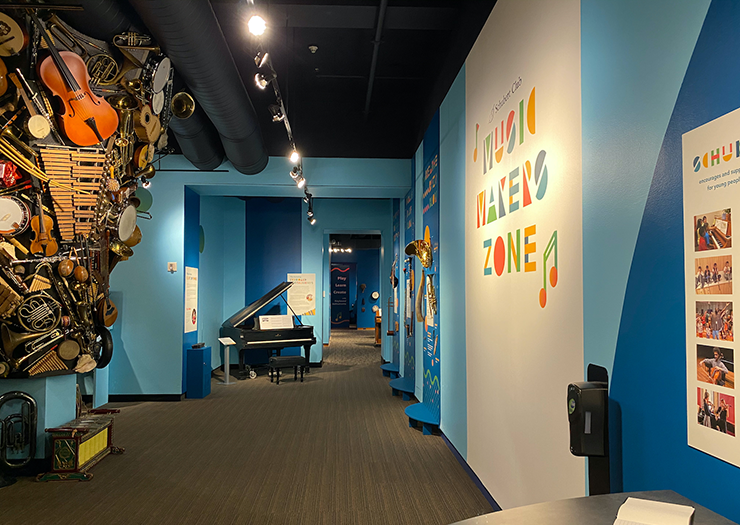 """A image of the Schubert Club Music Museum with an instrument """"tornado,"""" at left."""