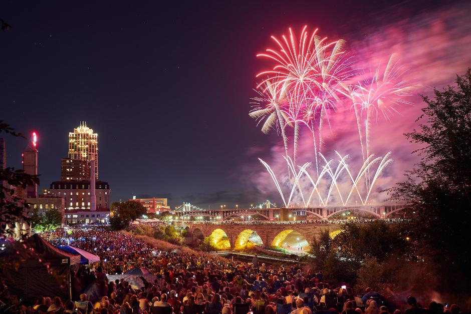 photo of fireworks over stone arch bridge in minneapolis
