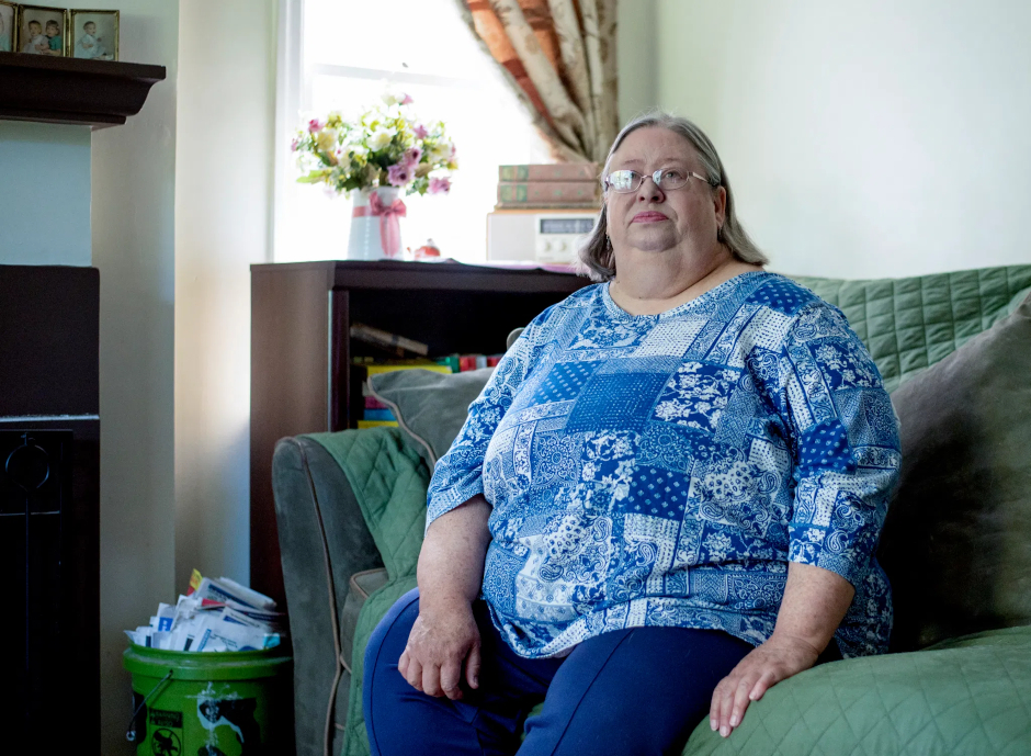 photo of karen miller sitting on her couch