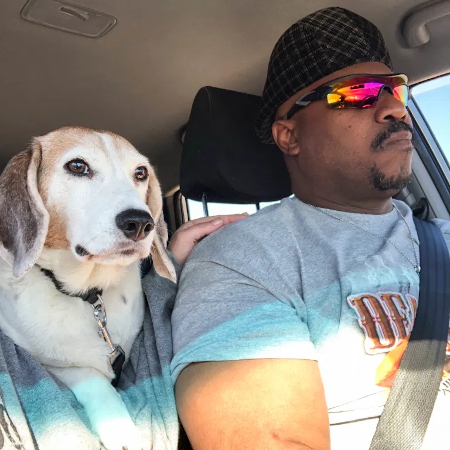 photo of pierre young in a car with his dog