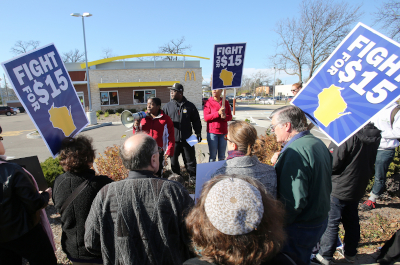 photo of protestors holding fight for 15 signs outside a mcdonalds