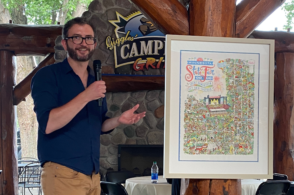 photo of kevin cannon discussing his illustration