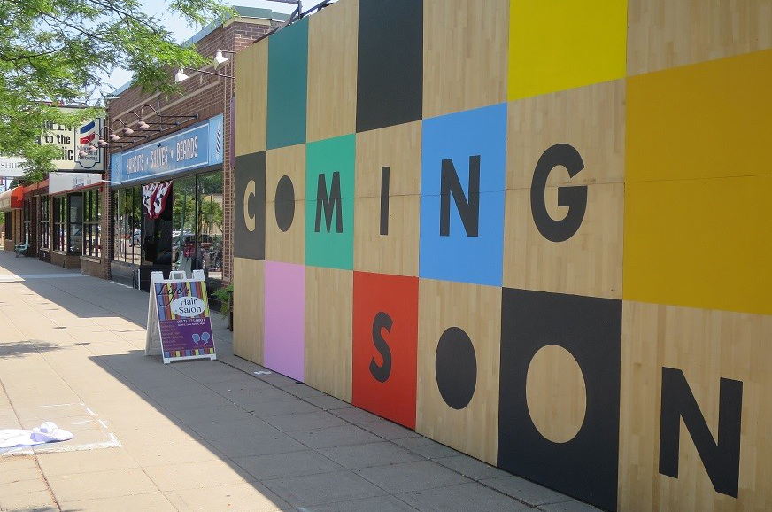 photo of plywood painted with coming soon mural