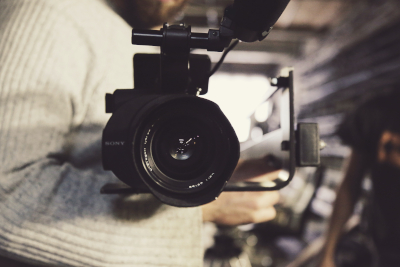 photo of camera lens pointed at viewer