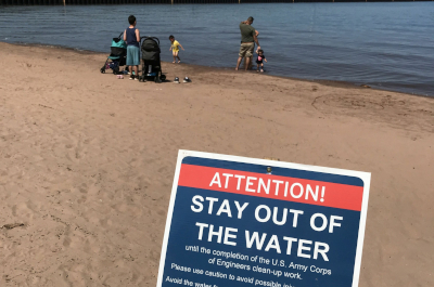 photo of a beach with a family by the water