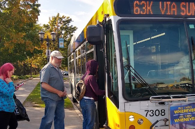 photo of people boarding bus