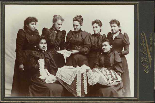 historic photo of women holding lace articles