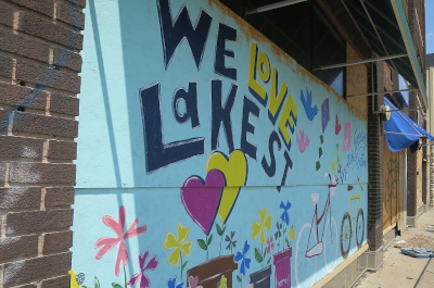 photo of plywood painted with a we love lake street mural