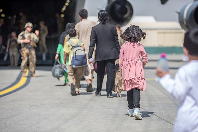 Afghan refugees boarding a U.S. Air Force C-17 Globemaster III transport plane during an evacuation at Hamid Karzai International Airport, Afghanistan.