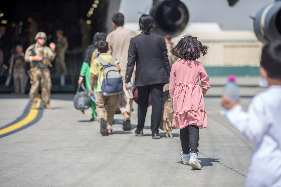 Afghan refugees boarding a U.S. Air Force C-17 Globemaster III transport plane during an evacuation at Hamid Karzai International Airport, Afghanistan, on Monday.