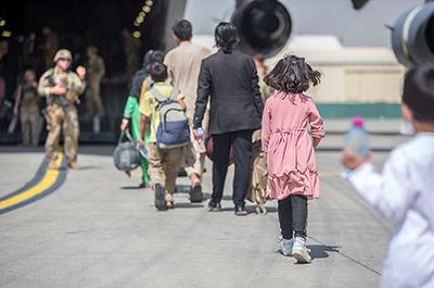 Afghan refugees boarding a U.S. Air Force C-17 Globemaster III transport plane