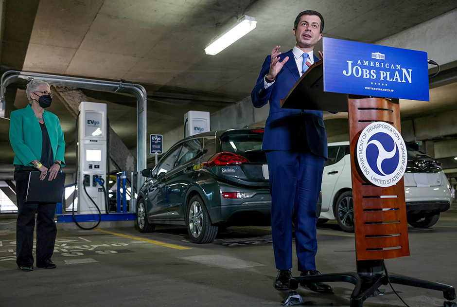 Transportation Secretary Pete Buttigieg, right, and White House Climate Advisor Gina McCarthy holding a news conference in the parking garage at Union Station in front of new EV charging stations in Washington, D.C.