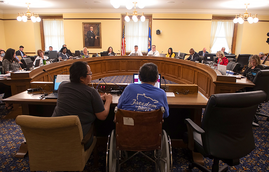 The Frontline Worker Pay Working Group takes testimony from Emilio Gonzales, a food production worker, during the groups first meeting at the Capitol on July 28.