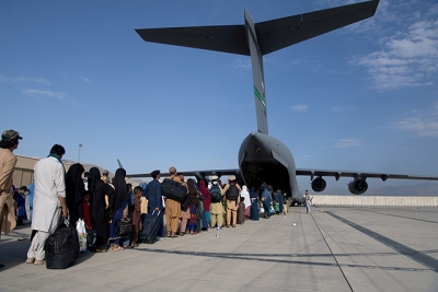 U.S. Air Force loadmasters and pilots assigned to the 816th Expeditionary Airlift Squadron, loading passengers aboard a U.S. Air Force C-17 Globemaster III during the Afghanistan evacuation at Hamid Karzai International Airport.