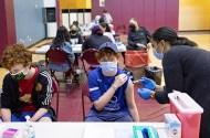 Teenagers receiving the coronavirus disease vaccine