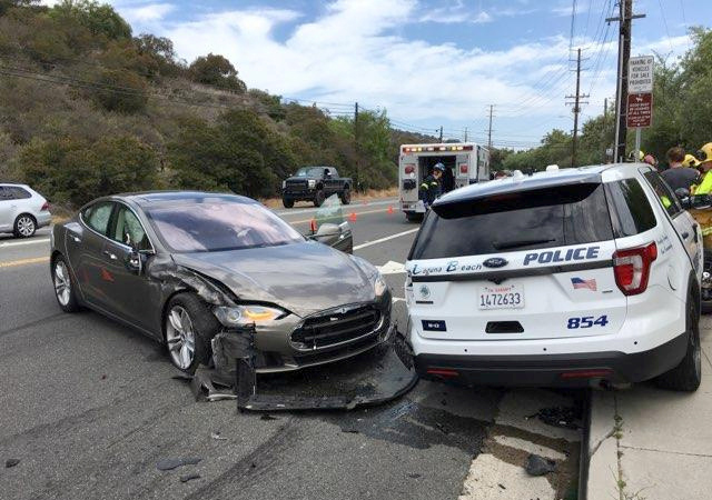 A Tesla sedan is shown after it struck a parked Laguna Beach Police Department vehicle in Laguna Beach, California, in this May 29, 2018, handout photo.